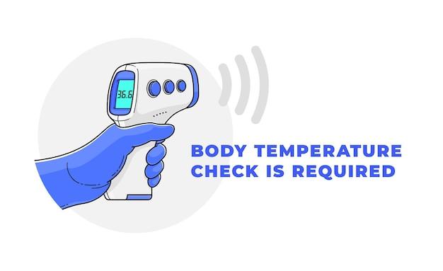 A mão na luva médica segura o termômetro infravermelho sem contato.