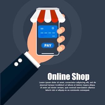 A mão segura o telefone com compras on-line e texto à direita.