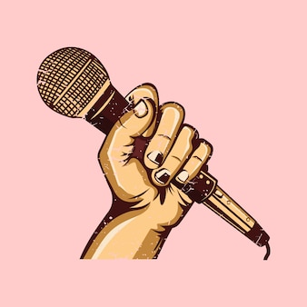A mão segurando o microfone de karaokê