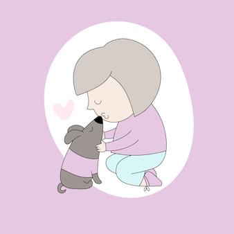 A menina bonito beija seu cão pequeno.