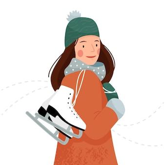 A menina carrega patins nas mãos mulher com patins de gelo