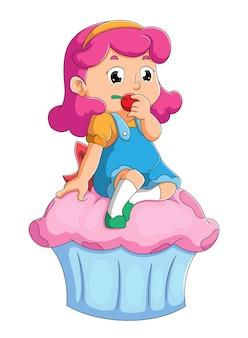 A menina está comendo a cereja e sentada no cupcake da ilustração