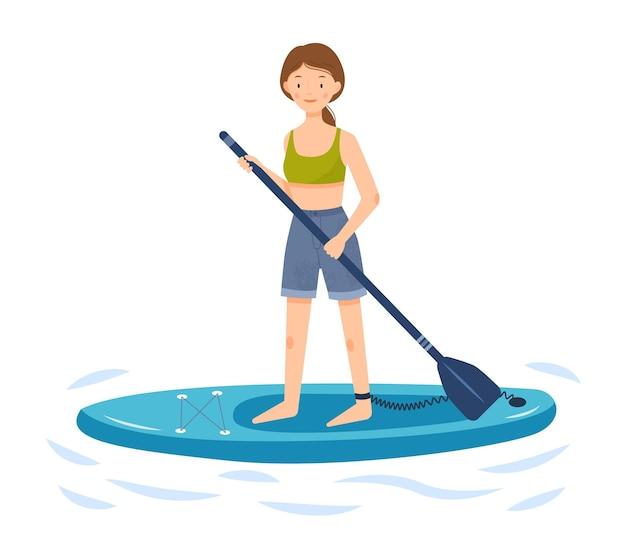 A menina está montando uma prancha de supino uma mulher está de pé em uma prancha de remo e segura um remo nas mãos