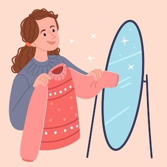 A menina experimenta um suéter aconchegante escolhendo roupas no guarda-roupa