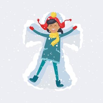 A menina feliz faz o anjo da neve.