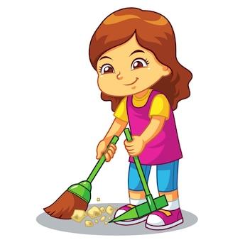 A menina limpa o lixo com a vassoura e a bandeja de poeira.