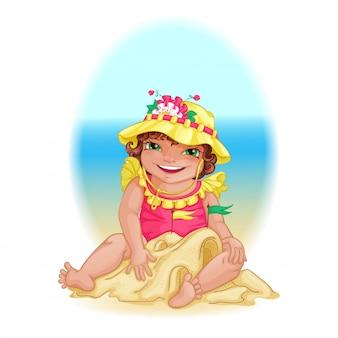 A menina no chapéu amarelo constrói um castelo da areia na praia.