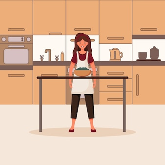 A menina prepara comida saudável na cozinha uma mulher cozinhando uma salada