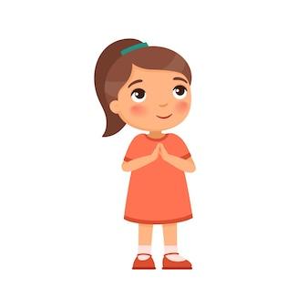 A menina sorri e levanta os olhos e as mãos em oração
