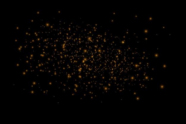A poeira faisca e as estrelas douradas brilham com luz especial. brilhos de vetor. efeito de luz. partículas de poeira mágica cintilante.