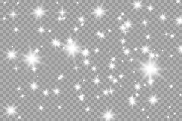 A poeira faisca e as estrelas douradas brilham com luz especial. brilhos de vetor.