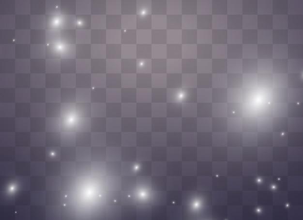 A poeira faisca e as estrelas douradas brilham com luz especial. efeito de luz de natal. partículas de poeira mágica cintilante.