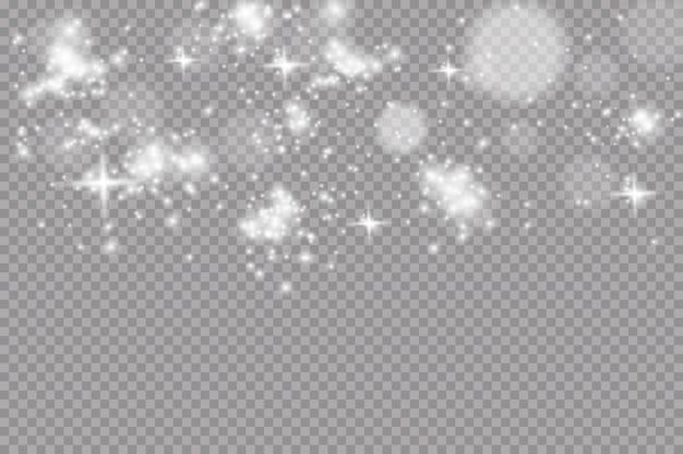 A poeira faisca e as estrelas douradas brilham com luz especial. efeito de luz. neve.