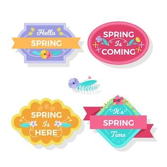A primavera está aqui emblemas com fitas