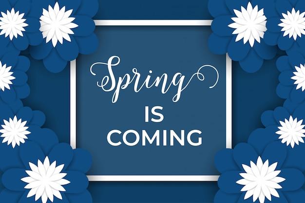 A primavera está chegando com flores de papel azul e branco