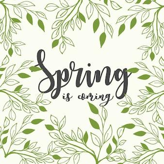 A primavera está chegando letras com folhas de ramos sobre fundo verde claro