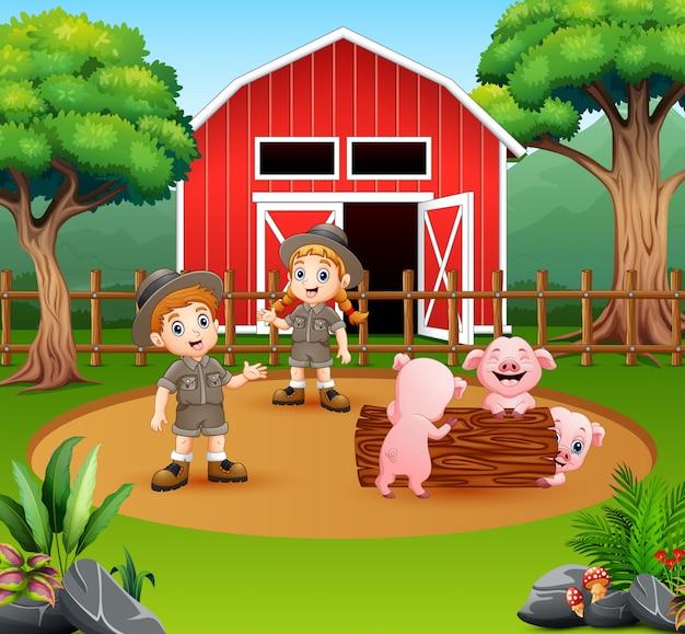 A tratadores menino e menina no quintal da fazenda