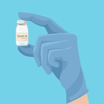 A vacina covid-19 na mão do médico.