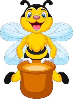 Abelha de desenho animado com pote de mel