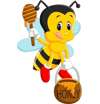 Abelha segurando mel