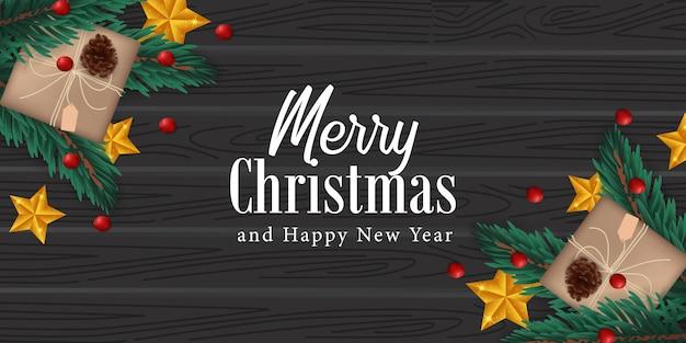 Abeto realista elegante deixa decoração guirlanda, pinha, estrela dourada na madeira preta para o natal