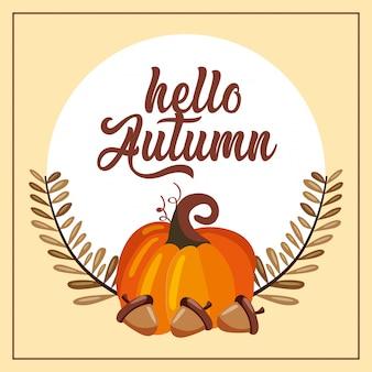 Abóbora com bolotas sobre ramo de folhas de outono