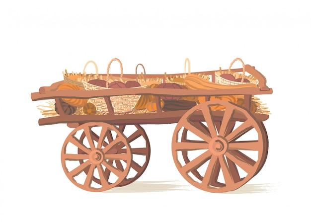 Abóboras em um carrinho de madeira
