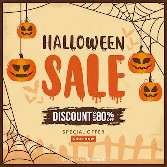 Abóboras em vendas de halloween de teias de aranha