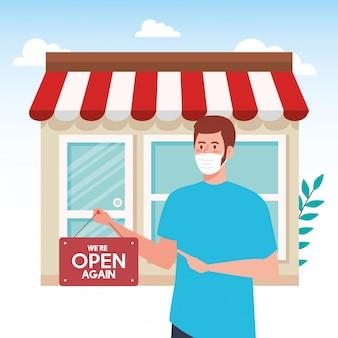Abra novamente depois da quarentena, homem com etiqueta de reabertura da loja, estamos abertos novamente, fachada da loja da loja