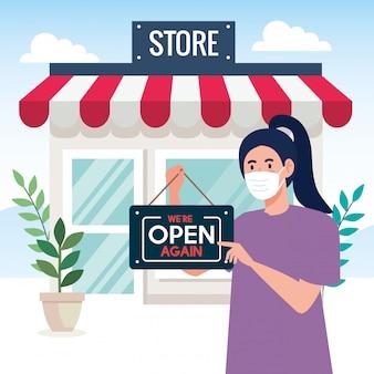 Abra novamente depois da quarentena, mulher com etiqueta de reabertura da loja, estamos abertos novamente, fachada da loja da loja