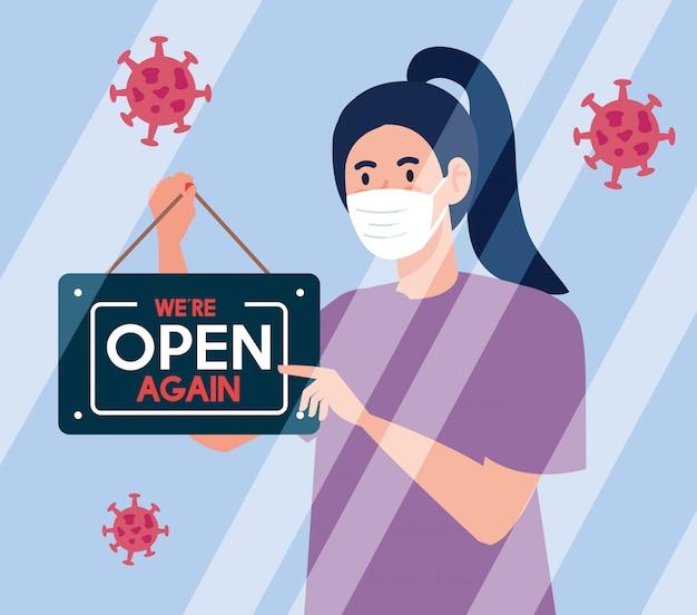 Abra novamente depois da quarentena, mulher com etiqueta de reabertura da loja, estamos abertos novamente