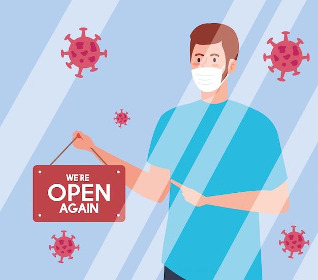 Abra novamente depois da quarentena, reabrindo da loja, o homem com etiqueta de nós estamos abertos novamente