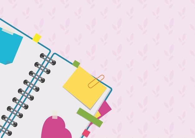 Abra o bloco de notas em uma espiral com marcadores e páginas em branco.