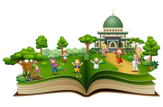 Abra o livro com crianças muçulmanas felizes na frente de uma mesquita