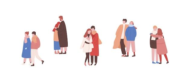 Abraçando casais em roupas quentes conjunto de ilustrações planas.