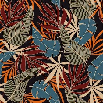 Abstrata sem costura padrão tropical com plantas e folhas azuis e vermelhas brilhantes