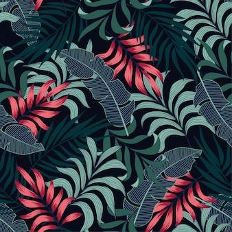 Abstrata sem costura padrão tropical com plantas e folhas vermelhas e azuis brilhantes