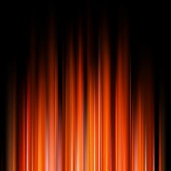 Abstratas luzes laranja em fundo escuro.