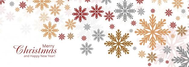 Abstrato colorido cartão de flocos de neve de natal