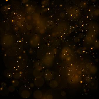Abstrato com efeito bokeh ouro, partículas de poeira.