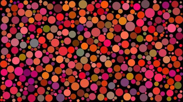 Abstrato de círculos de diferentes tamanhos em tons de vermelho em fundo preto.