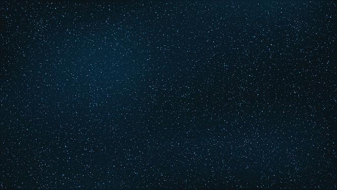 Abstrato. o lindo céu estrelado é azul.