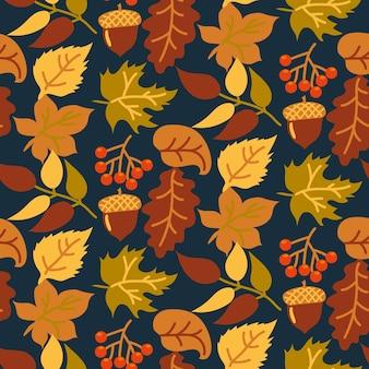 Abstrato sem costura de outono com folhas amarelas e laranja em um fundo escuro.