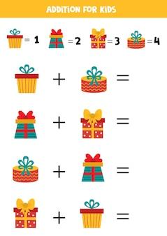 Acréscimo com caixas de presente de natal. jogo matemático para crianças. Vetor Premium