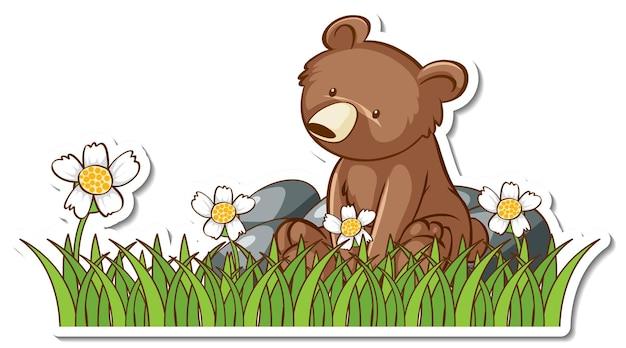 Adesivo de urso pardo sentado em um campo de grama