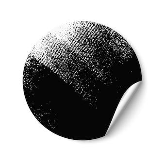 Adesivo redondo vazio em branco parcialmente pintado de preto com rolo de pintura. autocolante com rebordo arredondado. adesivo promocional em fundo branco.