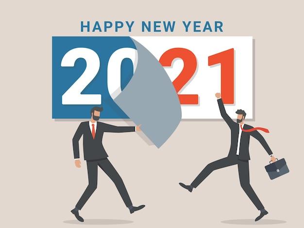 Adeus, 2020. um empresário arranca uma folha do calendário do ano anterior. partindo no próximo ano.