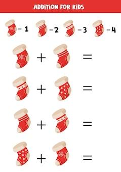 Adição com meias de natal dos desenhos animados. jogo educativo de matemática para crianças.