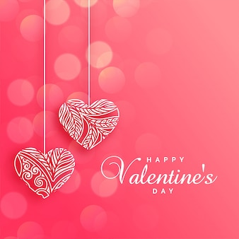 Adoráveis corações decorativas em fundo rosa bokeh