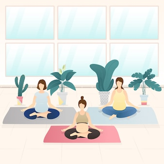Adoráveis mulheres grávidas fazendo yoga meditação juntos.
